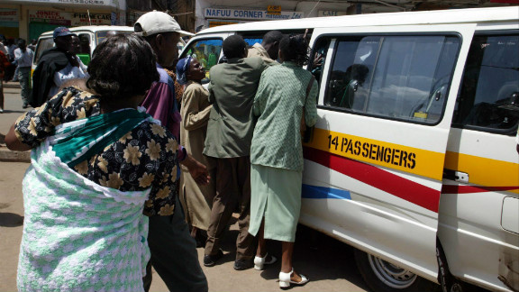 """In Nairobi, many people have to ride to work in crowded, privately owned minibus taxis called """"matatus."""""""