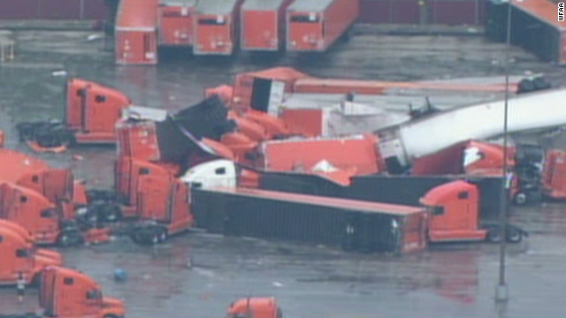 Tornado leaves truck trailers in piles