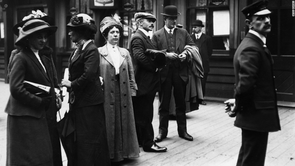 Survivors of the Titanic catastrophe arrive in Liverpool, England, in May 1912. Third Officer William Pitman, in the cap, stands on the right.