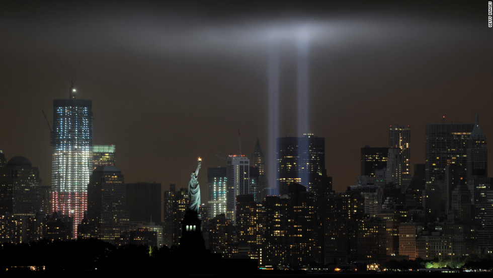 "Stephen Cox believes 9/11 is the only catastrophe with enough stories of courage, resilience, and tragedy to live on in memory like that of the Titanic.  Here, the ""Tribute in Light"" memorial illuminates the sky with ghosts of the World Trade Center's twin towers on the 10th anniversary of the terror attacks."