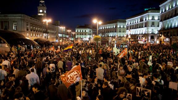 Demonstrators crowd Cibeles Square during a general strike last week in Madrid, Spain.