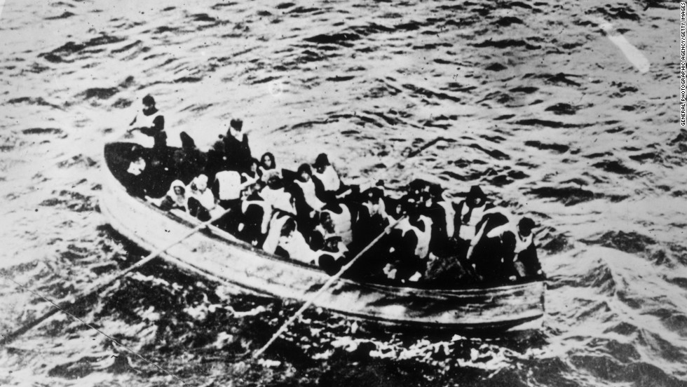 The ship struck an iceberg near midnight on April 14, 1912 and sank into the Atlantic Ocean a little less than four hours later. Survivors of the Titanic disaster crowded into lifeboats.