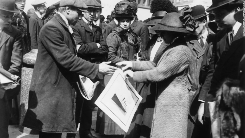 A woman buys a souvenir print of the Titanic shortly after the disaster.
