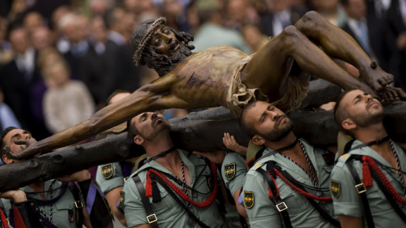 """Members of the Spanish Legion carry a statue of """"Christ of the Good Death"""" to Santo Domingo de Guzman Church in Malaga, Spain, during a Holy Week procession."""