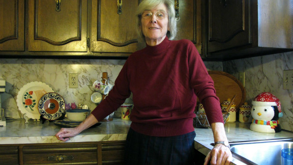 Anneliese MacPhail stands in the kitchen in her home in Columbus, Georgia, where her son Mark always stood.