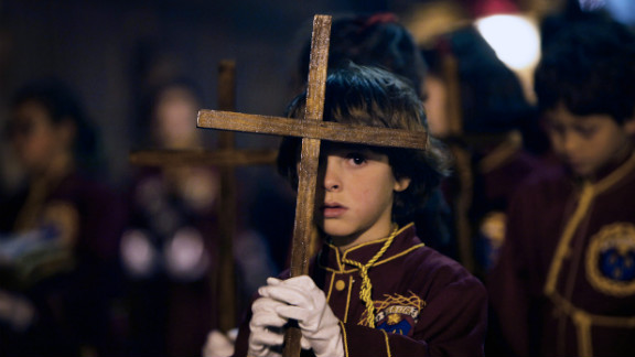 Children take part in a procession of the Padre Jesus Nazareno brotherhood during Holy Week on Tenerife, one of Spain