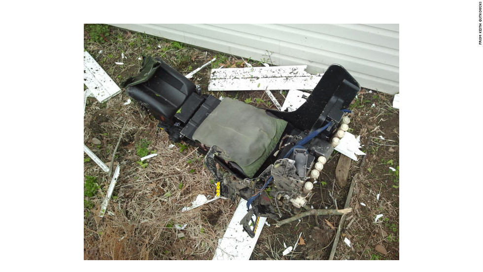 One of the plane's seats lies near the crash site. Retired rescue squad member Pat Kavanaugh said he and others found one of the two plane crew members who ejected.