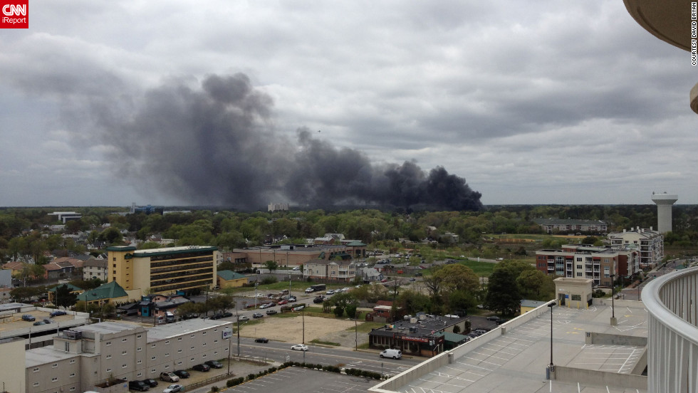 "iReporter David Bryan saw smoke from his hotel balcony in Virginia Beach and shot this photo. ""You could smell the jet fuel, and all we could see was the black smoke,"" he said."