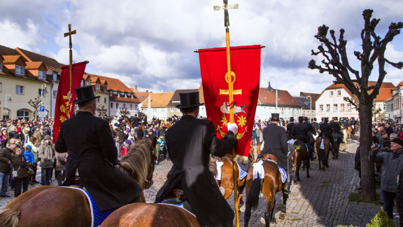 Easter riders parade on horseback on Sunday in Wittichenau, Germany.
