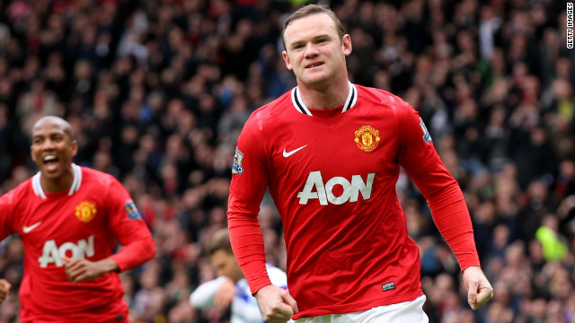 Wayne Rooney celebrates scoring in Manchester United's 2-0 win over QPR at Old Trafford.
