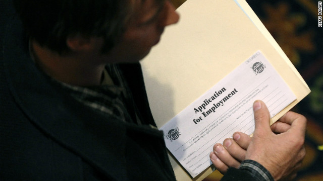 A job seeker holds an employment application during a job fair last month in San Francisco.
