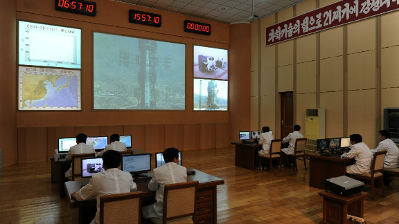 North Korean technicians work at the control room of the Tongchang-ri space center on April 8. The North Korean regime insists it