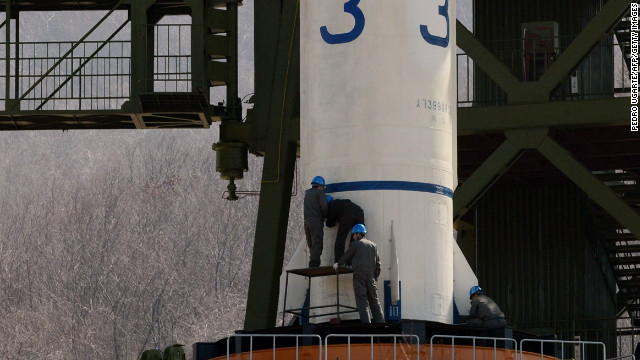 North Korean technicians check the Unha-3 rocket at Tangachai -ri space center on April 8.