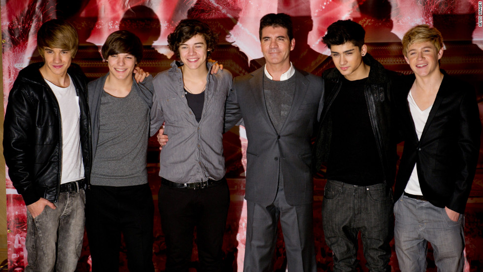 Simon cowell on one directions rise to stardom cnn simon cowell center shown here with one direction in 2010 voltagebd Choice Image