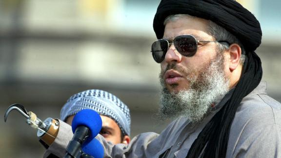 Radical cleric  Abu Hamza gestures at the