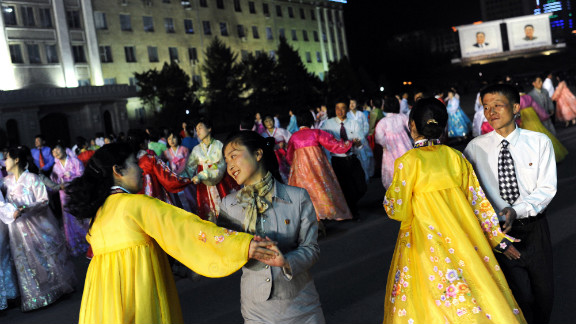 Citizens dance on Monday during a rehearsal for the commemoration of Kim Il-Sung