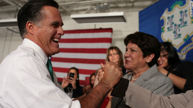 Mitt Romney greets supporters Wednesday at Alpha Graphics in Hartford, Connecticut.