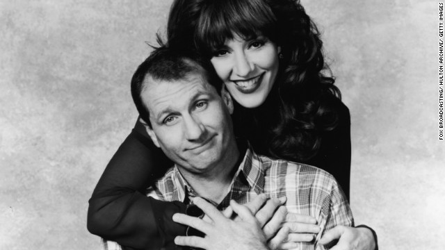 "Ed O'Neill and Katey Sagal shown here in a promotional poster for ""Married ... with Children."""