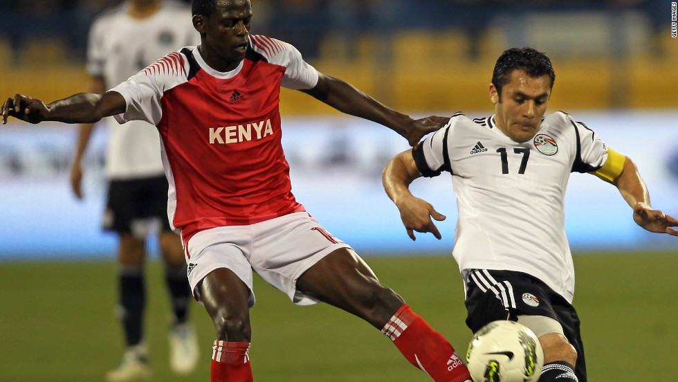 Hassan challenges Kenya's Raphael Mungai Kiongera during a friendly football match in Doha, Qatar, on February 27. It was his 179th appearance for  Egypt, making him the most-capped international footballer in history.