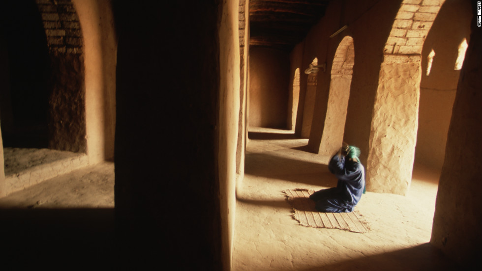 A man prays inside the Sankore mosque in Timbuktu, Mali. The city is now in the hands of rebels who have proclaimed it part of an independent Tuareg state, Azawad.