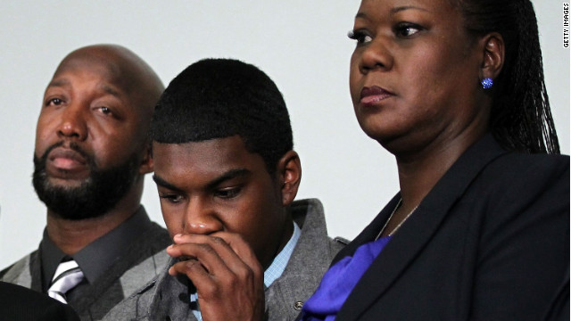 WASHINGTON, DC - APRIL 11: Family of Trayvon Martin who was fatally shot by neighborhood watch captain George Zimmerman in Florida, mother Sybrina Fulton (R), brother Jahvaris Fulton (2nd R), and father Tracy Martin (L) listen during a news conference April 11, 2012 in Washington, DC. It has been reported that Zimmerman will be charged in the Trayvon Martin shooting according to Florida special prosecutor Angela Corey. (Photo by Alex Wong/Getty Images)
