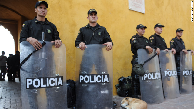 Riot police stand guard next to the media center of the Summit of the Americas in Cartagena, Colombia.