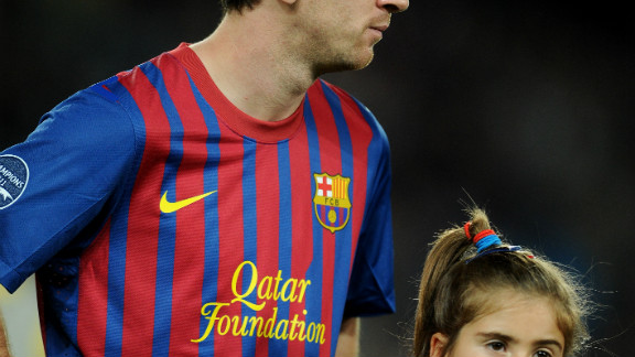 Three-time world player of the year Lionel Messi with a mascot wearing an anti-racism shirt ahead of Barcelona