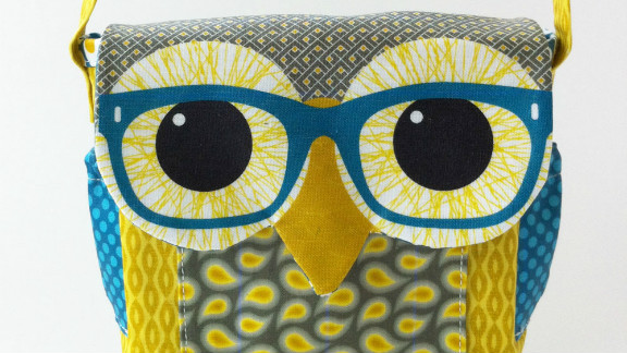 """Berene Campbell sewed this owl bag together from a pattern she designed herself. """"I do enjoy the now trendy graphic use of animals in fashion such as Rachel's sweaters on 'Glee.' Love that poodle sweater!"""" she said."""