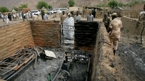 Sudanese soldiers and civilians inspect damage from clashes between the army and South Sudan's forces on April 12, 2012.