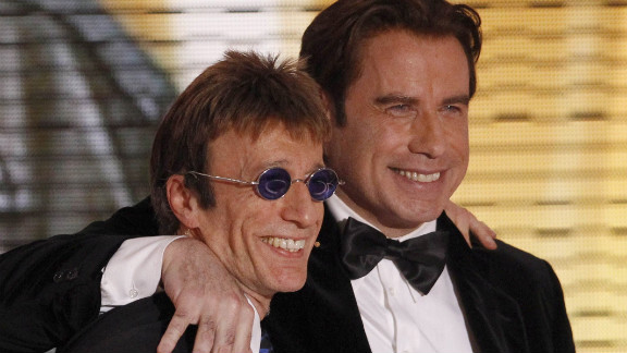 Robin Gibb and John Travolta pose after Gibb announced Travolta as the winner of a Golden Camera media prize in Berlin in February 2010.