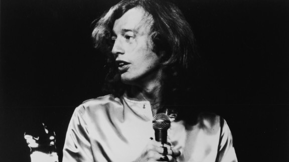 Robin Gibb sings on stage during a concert in London in 1975.