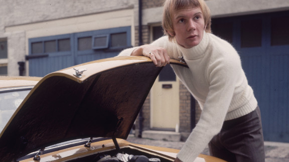 Australian musician Colin Petersen, a drummer with the popular disco group The Bee Gees, tinkering under the hood of his car in 1965.