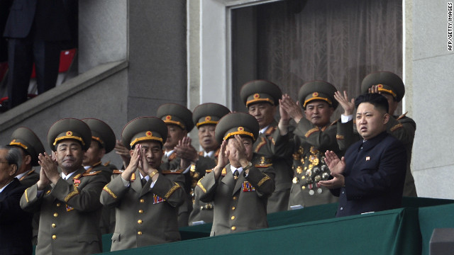 North Korean leader Kim Jong-Un (R) applauds with top military leaders during an official ceremony at a stadium in Pyongyang on April 14, 2012.