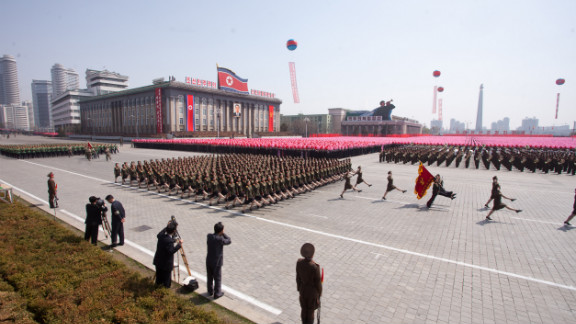 North Korean soldiers march past the podium during the parade in Pyongyang on Sunday.  Elaborate and extensive 100th anniversary celebrations of Kim Il Sung