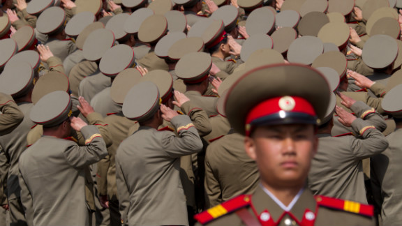 North Korean soldiers salute during Sunday