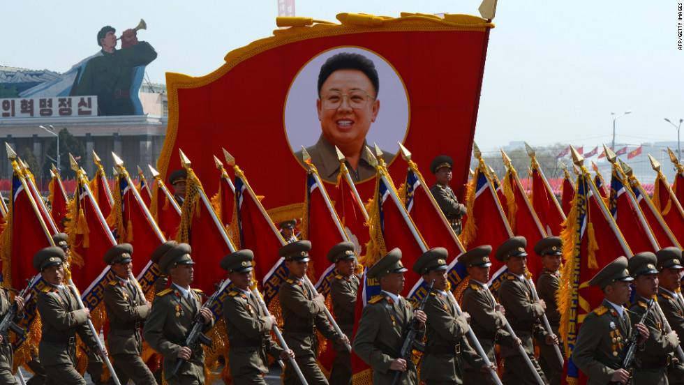 North Korean soldiers carry a portrait of late leader Kim Jong-Il during a military parade to mark 100 years since the birth of the country's founder Kim Il-Sung in Pyongyang on April 15, 2012. T