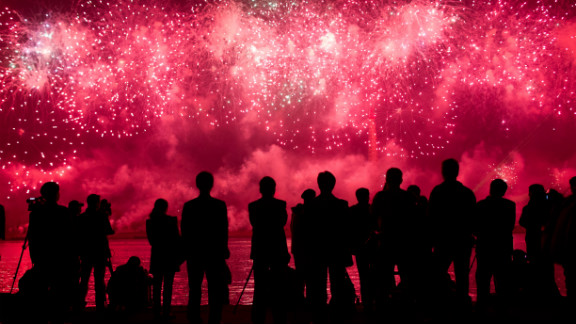 Spectators  watch a fireworks display to mark 100 years since the birth of North Korea