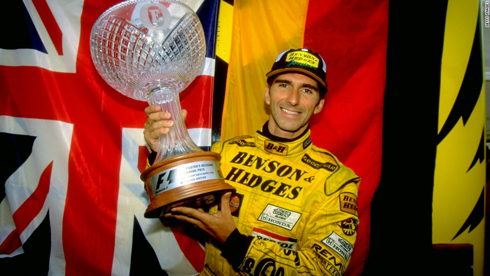 Damon Hill is one of Britain's most succesful drivers, winning 22 races in an eight-season career spanning from 1992 to 1999. Here he holds the trophy high after winning  the Belgian Grand Prix in 1993.
