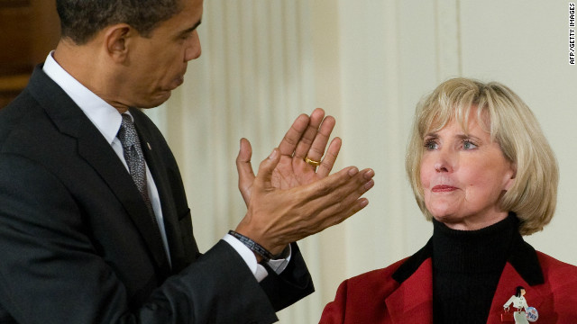 US President Barack Obama applauds Lilly Ledbetter before signing the Lilly Ledbetter Fair Pay Act in the East Room of the White House in Washington, DC, January 29, 2009. The wage discrimination bill, which allows employees more time to file a claim, is named after Lilly Ledbetter, a retired worker at a Goodyear factory in Alabama who discovered she was paid less than her male counterparts