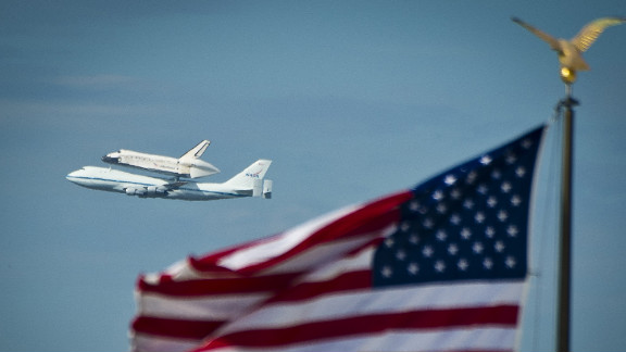Discovery flies over the National Mall on Tuesday as it arrives from Kennedy Space Center in Florida. The space shuttle Enterprise, which has been on display at the Smithsonian's Steven F. Udvar-Hazy Center since 1985, will be moved to the Intrepid Sea, Air & Space Museum in New York.