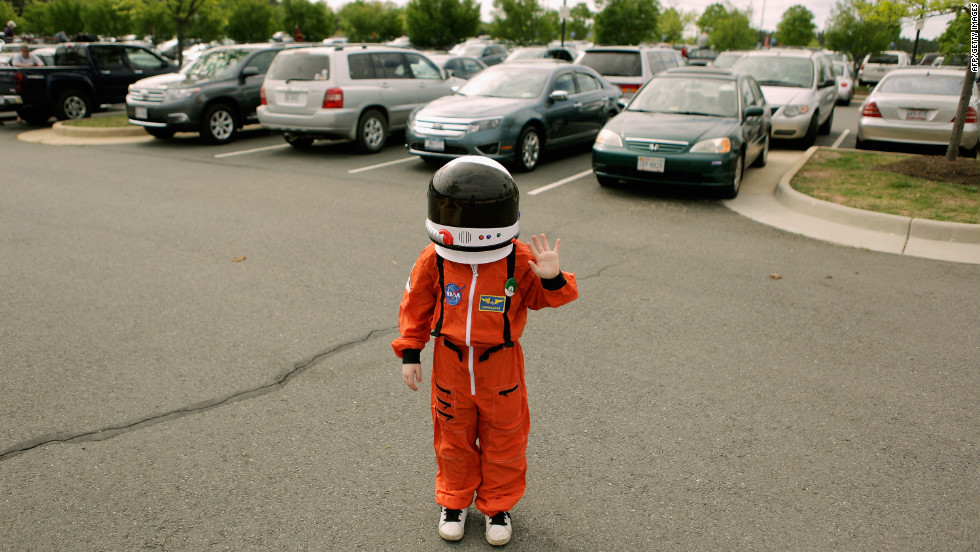 An aspiring astronaut poses in the parking lot of the Smithsonian National Air and Space Museum Steven F. Udvar-Hazy Center on Tuesday in Chantilly.