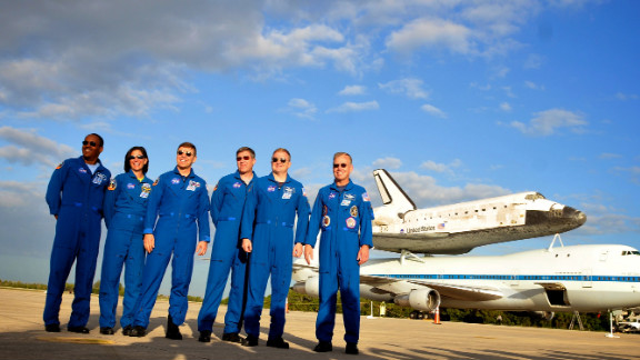 Alvin Drew, left, Nicole Stott, Mike Barratt, Steve Bowen, Eric Boe and Steve Lindsey of STS-133, Discovery's last crew, pose for a photo at Kennedy Space Center in  Cape Canaveral, Florida, on Monday, April 16.