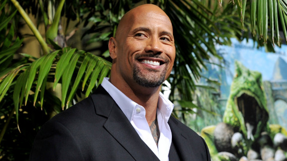 """Dwayne """"The Rock"""" Johnson arrives at the premiere of 'Journey 2: The Mysterious Island' at the Chinese Theater in February 2012 in Los Angeles, California"""