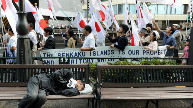 Anti-China protesters march in central Tokyo on October 16, 2010 over a group of islands claimed by both Japan and China.