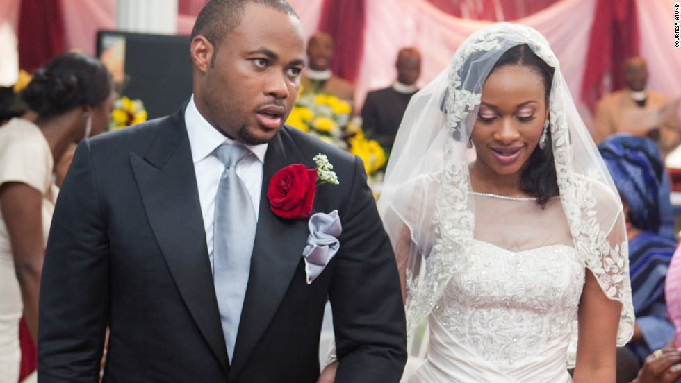 A bride and her husband at a Nigerian wedding. Nigerian weddings are becoming increasingly extravagant affairs.