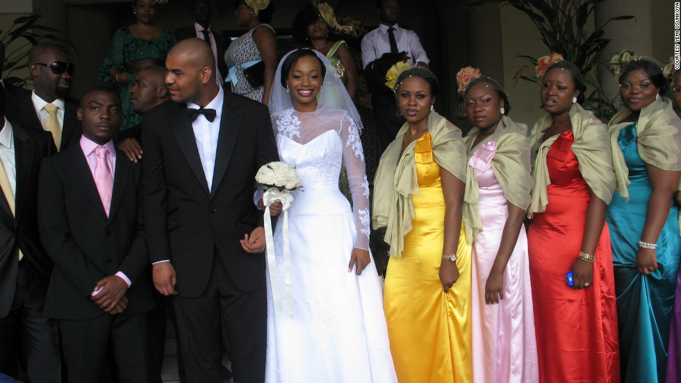 "A bride and the bridal party at a Nigerian wedding. Nigerian weddings feature two ceremonies: a traditional ceremony and a ""white wedding."""