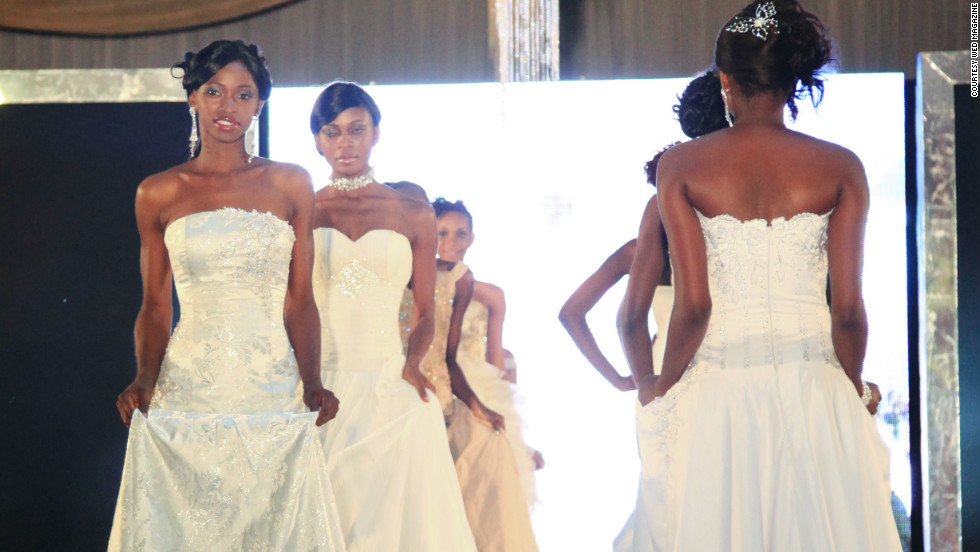 Models wear bridal gowns on the runway at a Lagos Wed Expo wedding exhibition. Organizers say about 10,000 people attended over two days.
