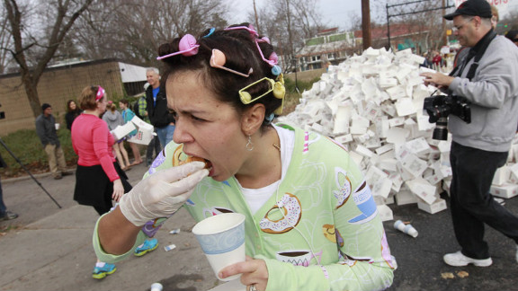 """Ah, the <a href=""""http://www.krispykremechallenge.com/"""" target=""""_blank"""" target=""""_blank"""">Krispy Kreme Challenge</a> -- one of the first races for binge-eating athletes. Now in it's ninth year, the challenge asks more than 7,000 runners to tackle 2.5 miles, eat one dozen doughnuts and then waddle back to the finish line at the North Carolina State University bell tower in Raleigh."""