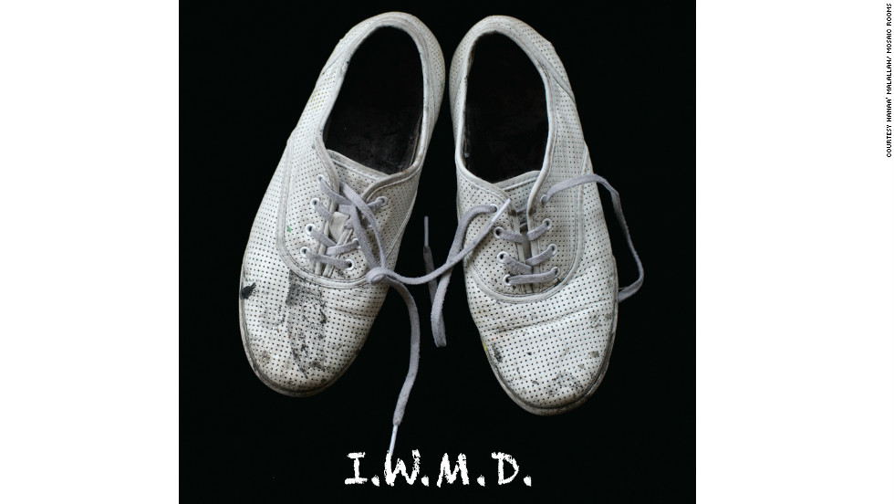 "Hanaa Malallah's 2011 artwork ""I.W.M.D"" shows a picture of her own shoes, labeled as 'Iraq's Weapons of Mass Destruction.'"