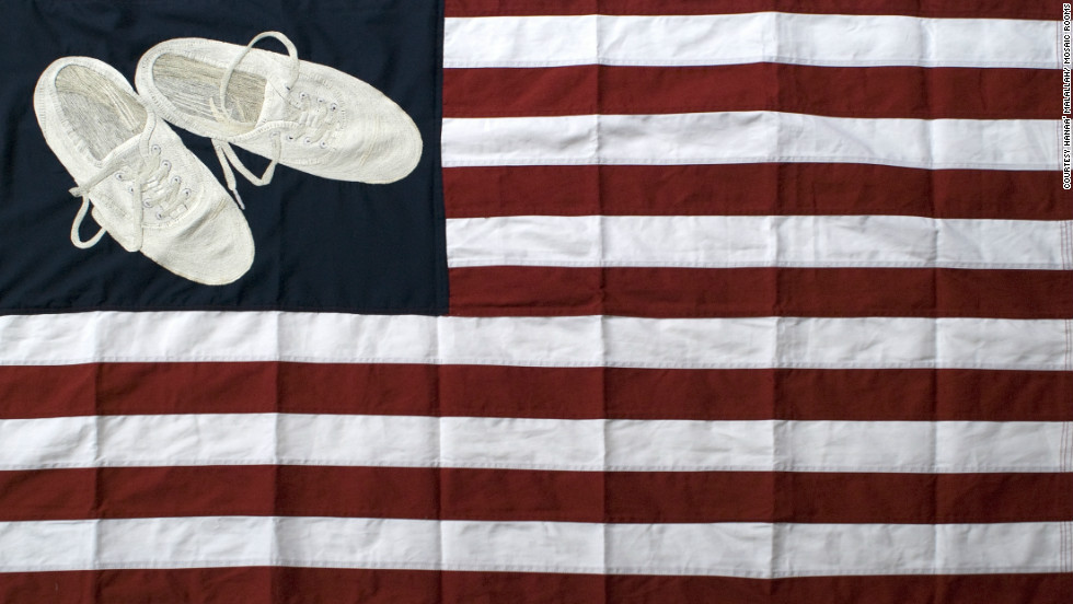"Images of Hanaa' Malallah's shoes appear in many of her artworks, including being embroidered in ""USA Heritage Flag,"" from 2012. Malallah is fascinated with the 2008 incident when an Iraqi journalist threw shoes at former President George W. Bush. ""Shoes are our way of resistance,"" said Malallah."